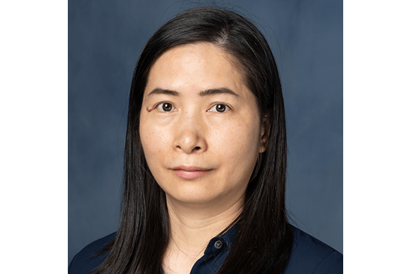 Portrait of Zheng research technician Wanyi Hu. She has long, straight black hair and is wearing a navy blouse.